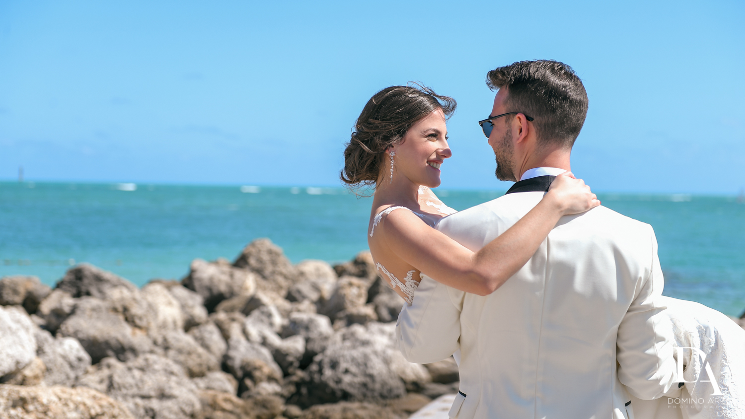ocean portraits brude and groom at Tropical Garden Wedding at Fisher Island Miami by Domino Arts Photography
