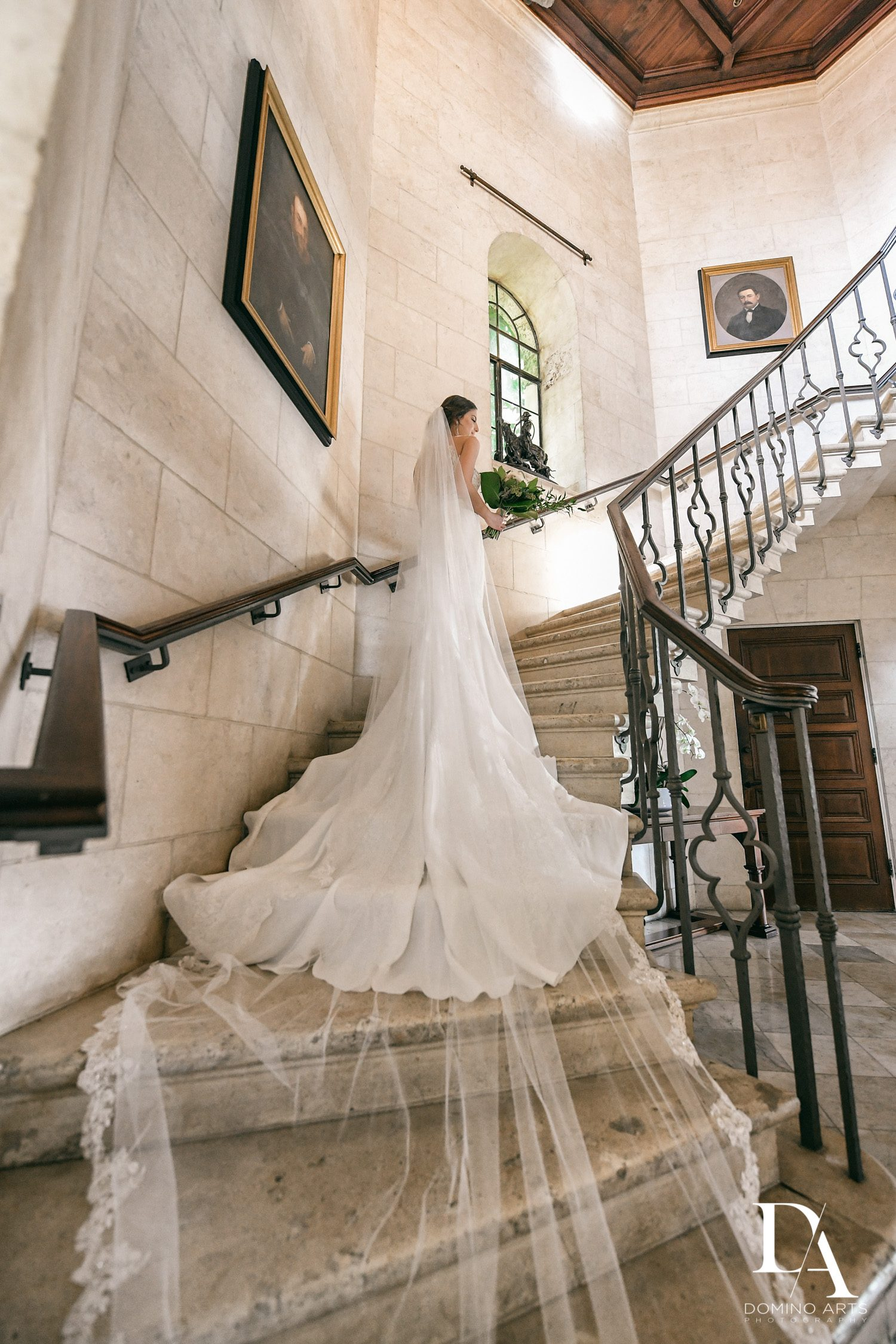 Bride on stairway at Tropical Garden Wedding at Fisher Island Miami by Domino Arts Photography