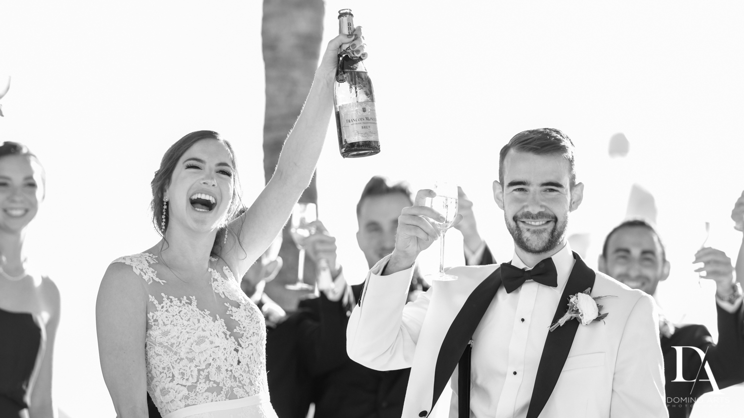 fun toast at Tropical Garden Wedding at Fisher Island Miami by Domino Arts Photography