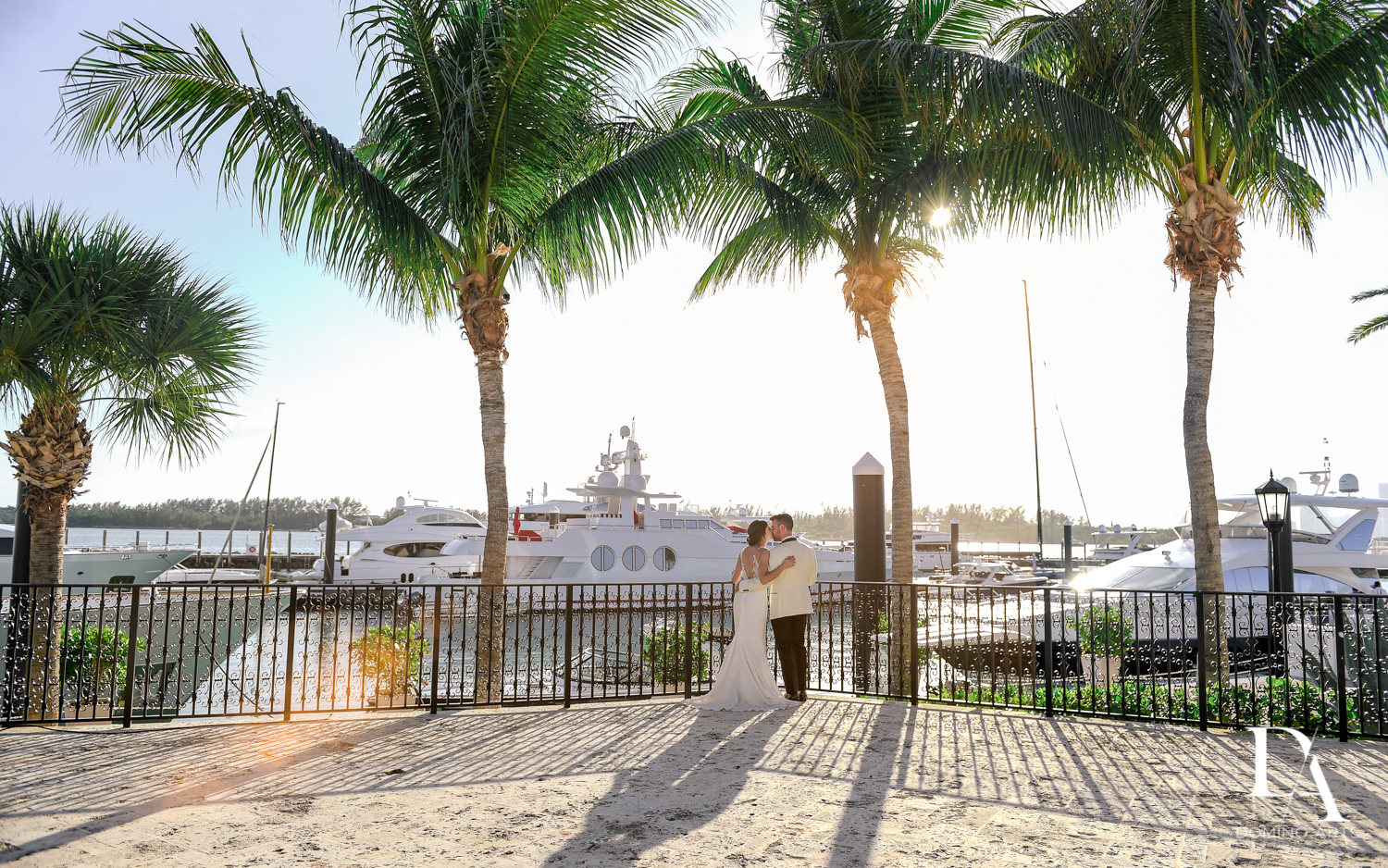 sunset marina at Tropical Garden Wedding at Fisher Island Miami by Domino Arts Photography