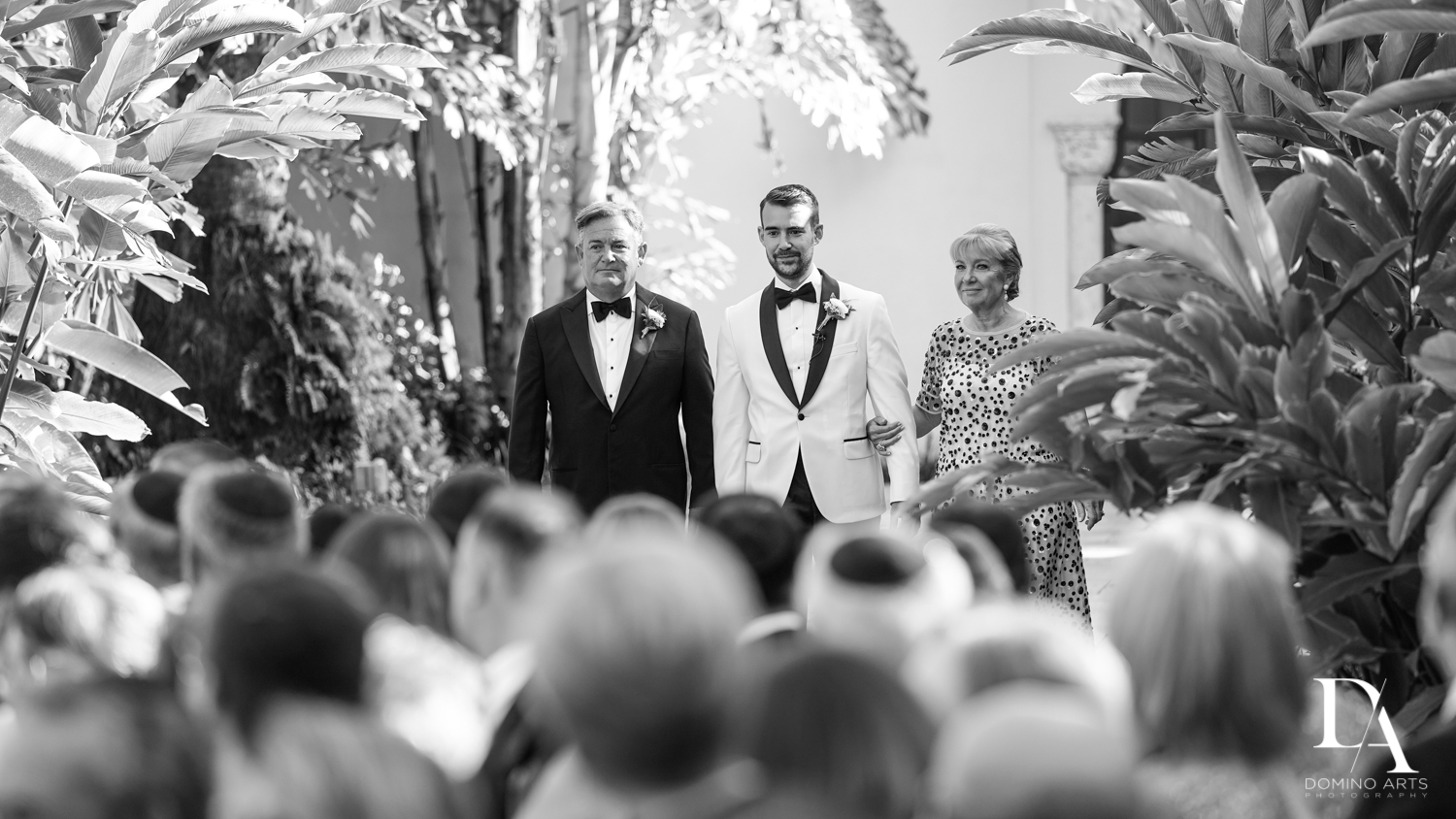 groom walking aisle at Tropical Garden Wedding at Fisher Island Miami by Domino Arts Photography