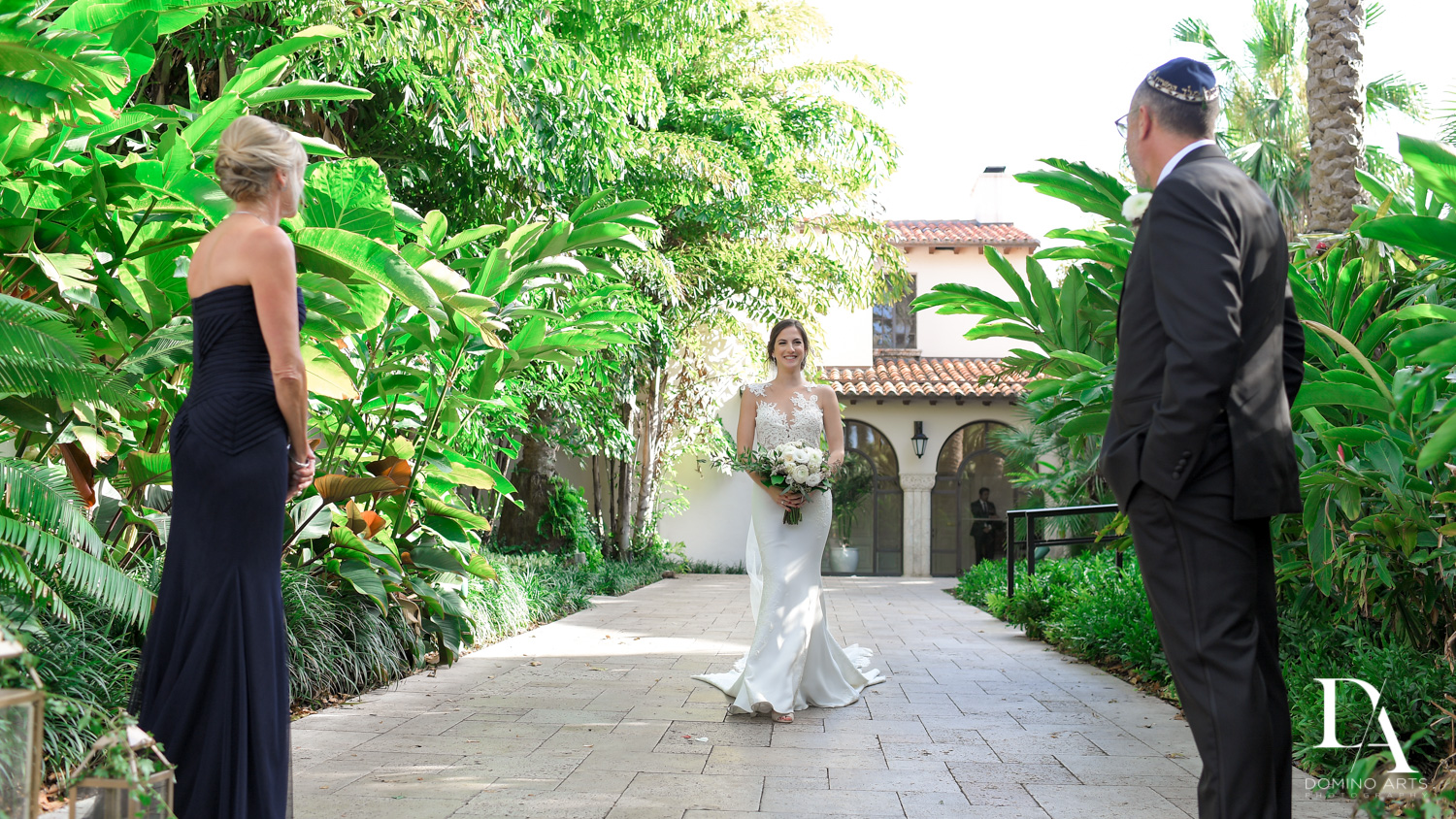 bride walking aisle at Tropical Garden Wedding at Fisher Island Miami by Domino Arts Photography