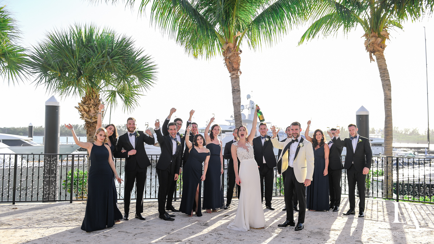 bridal party fun at Tropical Garden Wedding at Fisher Island Miami by Domino Arts Photography