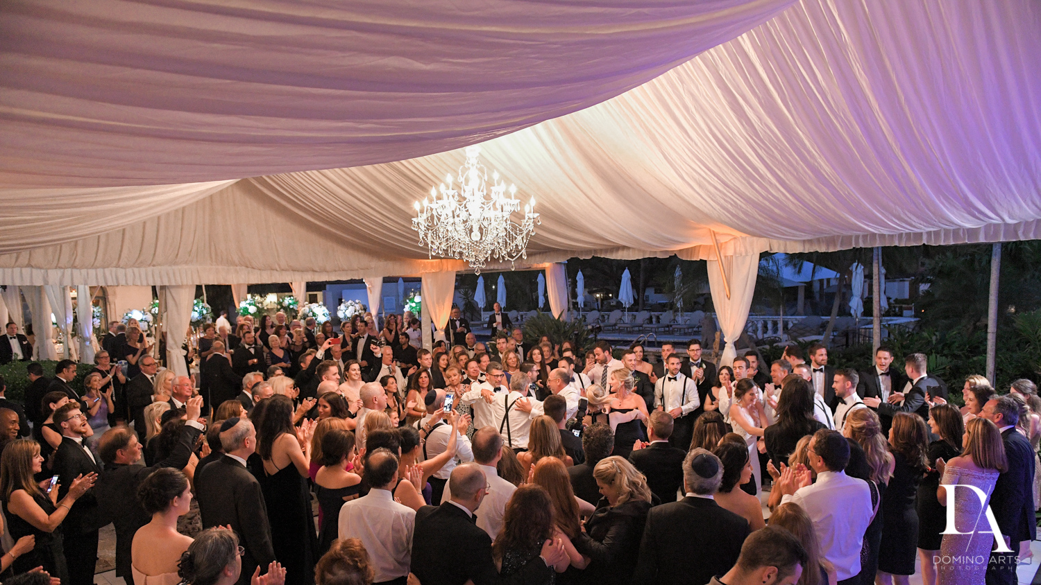 big fun party at Tropical Garden Wedding at Fisher Island Miami by Domino Arts Photography