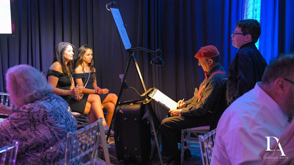 caricaturist stoyan art at New York Theme Bat Mitzvah at Woodfield Country Club, Boca Raton by Domino Arts Photography