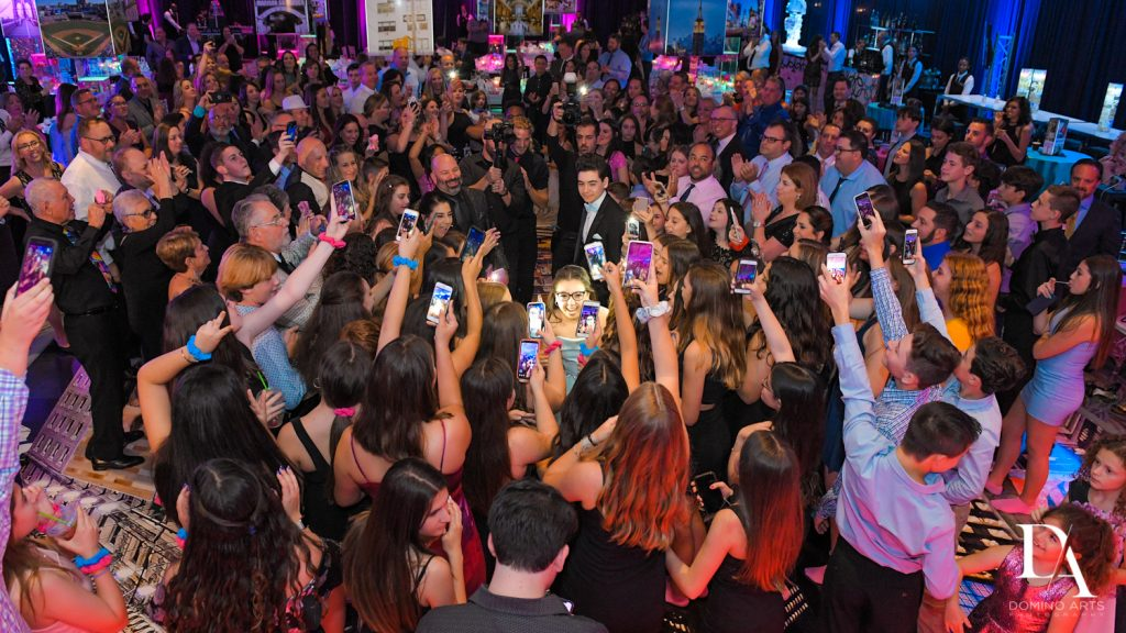 party entrance at New York Theme Bat Mitzvah at Woodfield Country Club, Boca Raton by Domino Arts Photography