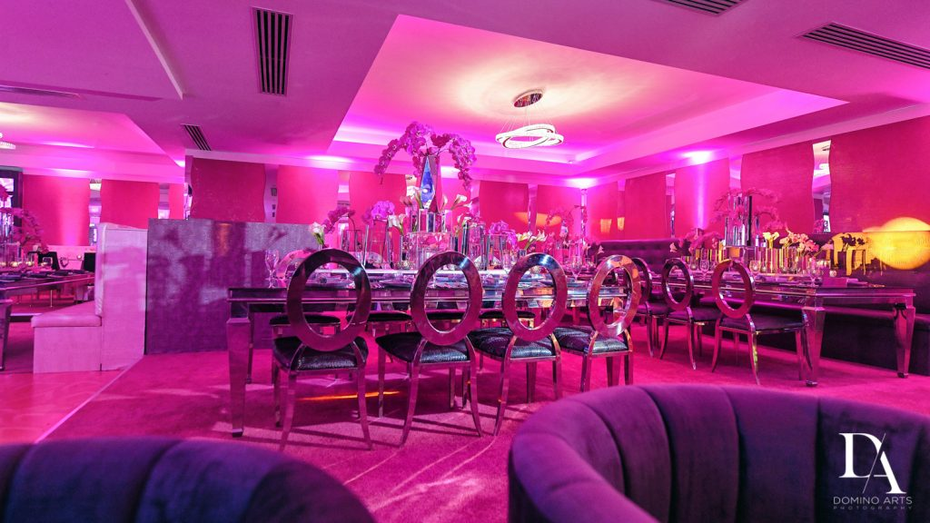 pink and purple modern decor at LUXURY BAT MITZVAH FEATURING ZEDD AT ST ANDREWS COUNTRY CLUB BY DOMINO ARTS PHOTOGRAPHY