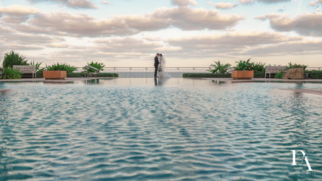 amazing pool picture at Romantic Ocean Side Wedding at Eau Palm Beach by Domino Arts Photography