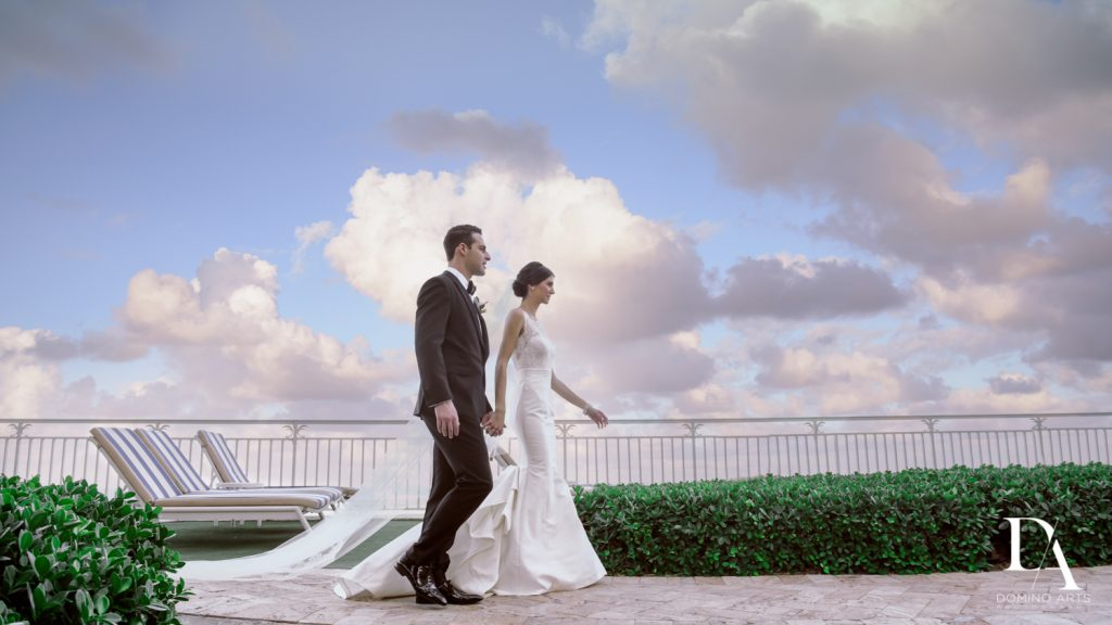 natural pics at Romantic Ocean Side Wedding at Eau Palm Beach by Domino Arts Photography