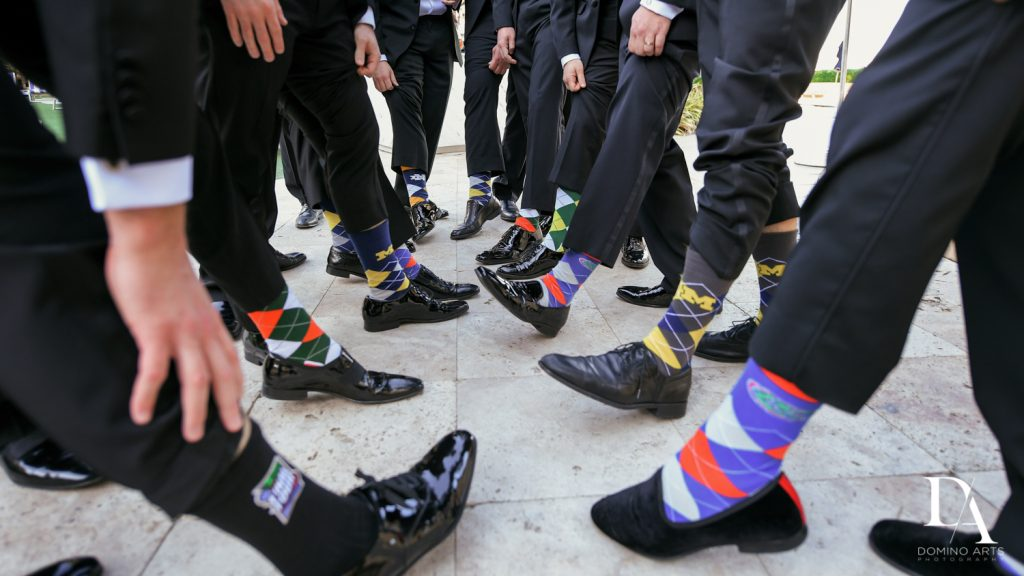 fun socks at Romantic Ocean Side Wedding at Eau Palm Beach by Domino Arts Photography