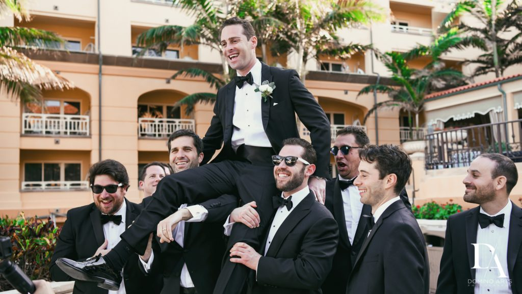 groomsmen at Romantic Ocean Side Wedding at Eau Palm Beach by Domino Arts Photography