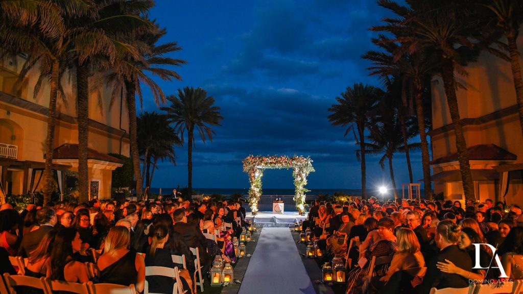 ceremony at Romantic Ocean Side Wedding at Eau Palm Beach by Domino Arts Photography