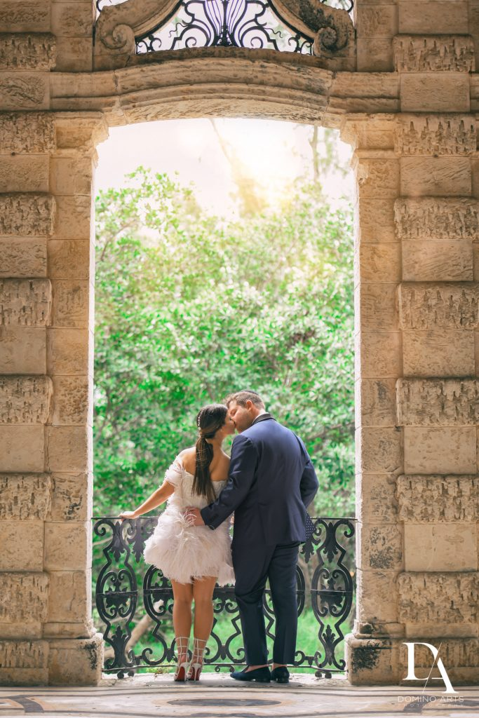 Kissing at Haute Couture Engagement Session at Vizcaya Museum and Gardens Miami by Domino Arts Photography