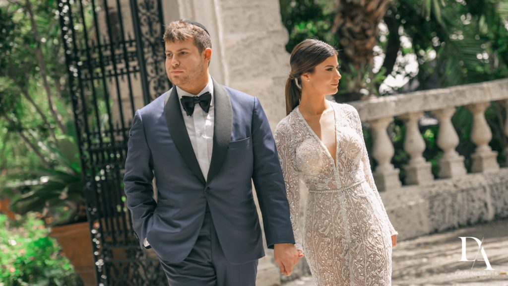 casual couple at Haute Couture Engagement Session at Vizcaya Museum and Gardens Miami by Domino Arts Photography