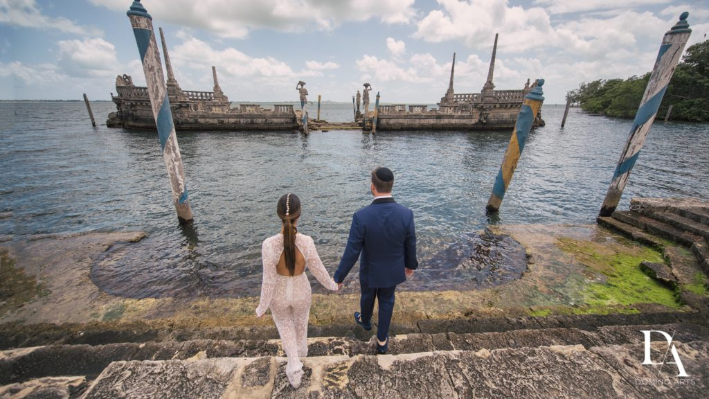 elegant couple ocean side at Haute Couture Engagement Session at Vizcaya Museum and Gardens Miami by Domino Arts Photography