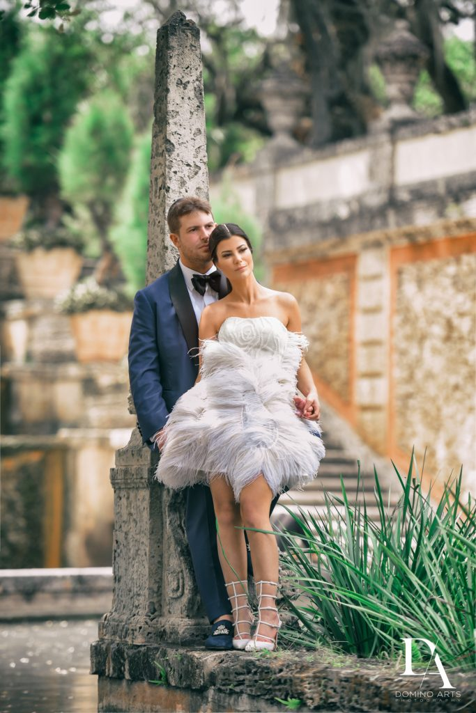Karen Sabag feather dress at Haute Couture Engagement Session at Vizcaya Museum and Gardens Miami by Domino Arts Photography