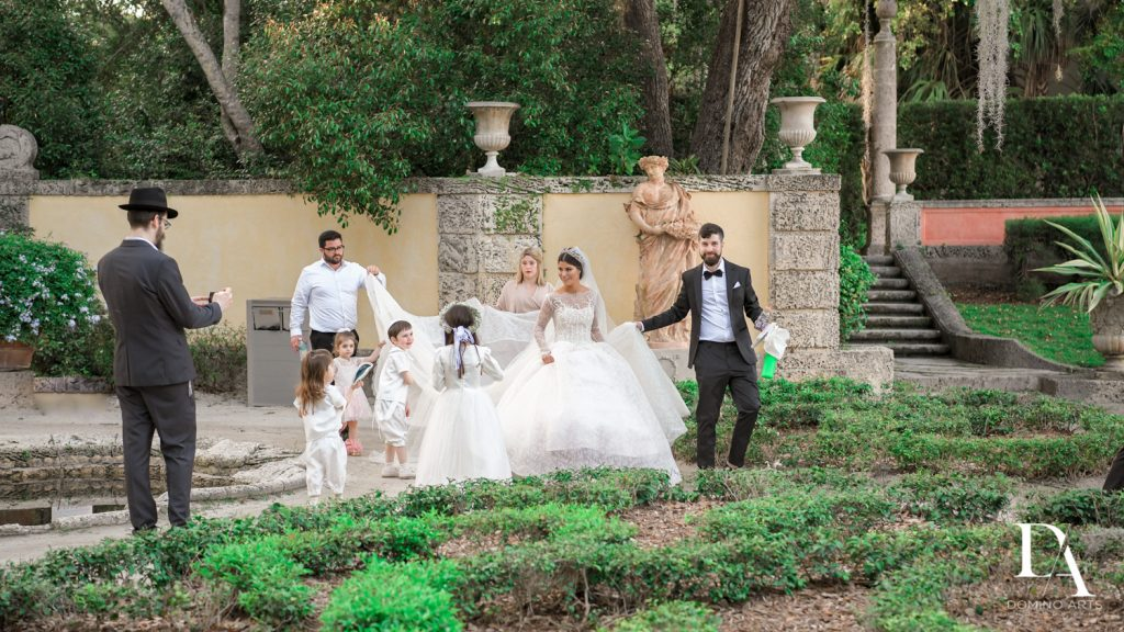 family at Haute Couture Dream Wedding at Vizcaya Museum & Gardens by Domino Arts Photography