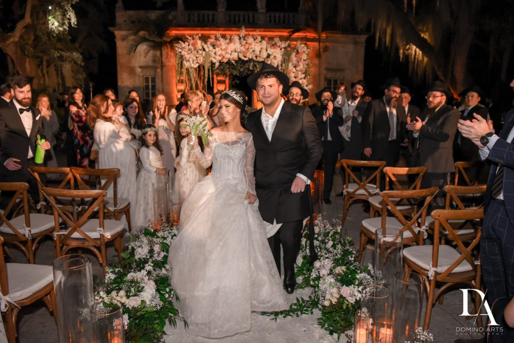 just married at Haute Couture Dream Wedding at Vizcaya Museum & Gardens by Domino Arts Photography