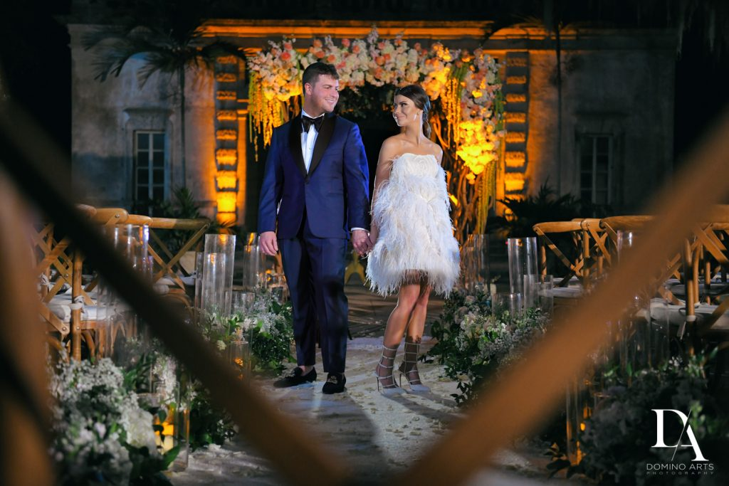 bride and groom at Haute Couture Dream Wedding at Vizcaya Museum & Gardens by Domino Arts Photography