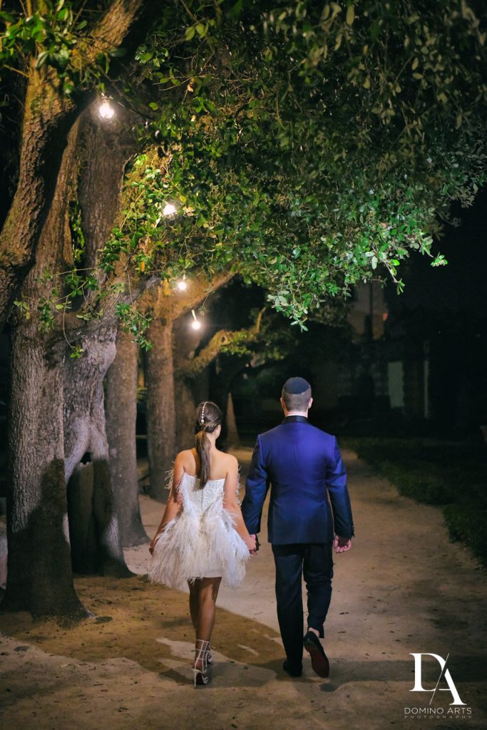 bride and groom exit at Haute Couture Dream Wedding at Vizcaya Museum & Gardens by Domino Arts Photography