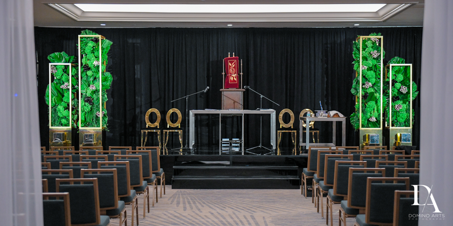 ceremony decor at Designer invitations at Stylish Architectural B'Nai Mitzvah at the NEW JW Marriott Miami Turnberry Resort & Spa by Domino Arts Photography