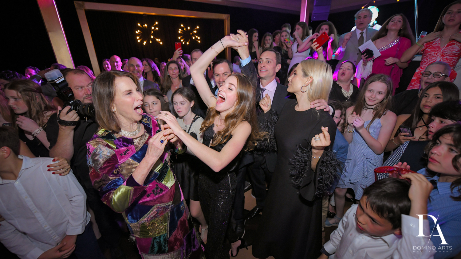 fun hora at Designer invitations at Stylish Architectural B'Nai Mitzvah at the NEW JW Marriott Miami Turnberry Resort & Spa by Domino Arts Photography
