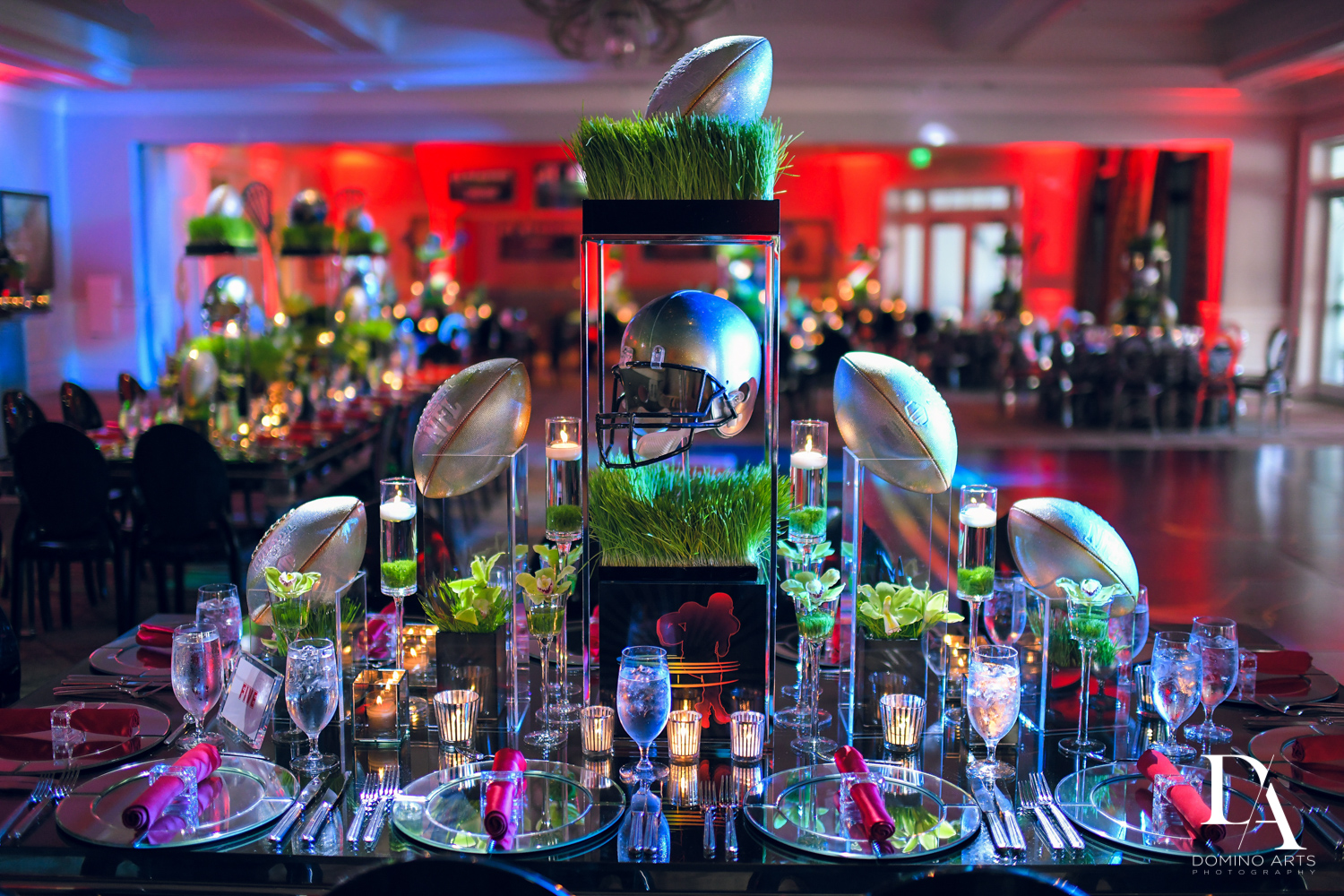 awesome football decor at Football Theme Bar Mitzvah at Temple Beth El and Royal Palm Yacht Club by Domino Arts Photography