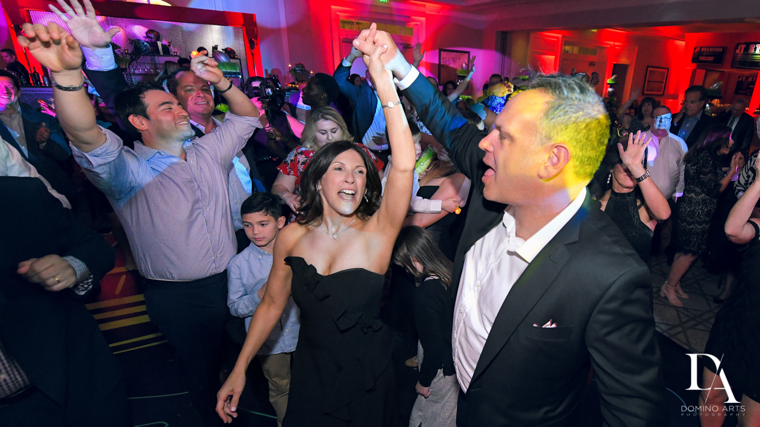 fun party pictures at Football Theme Bar Mitzvah at Temple Beth El and Royal Palm Yacht Club by Domino Arts Photography