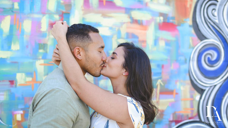 kissing at Romantic Engagement Session at Graffiti Walls by Domino Arts Photography