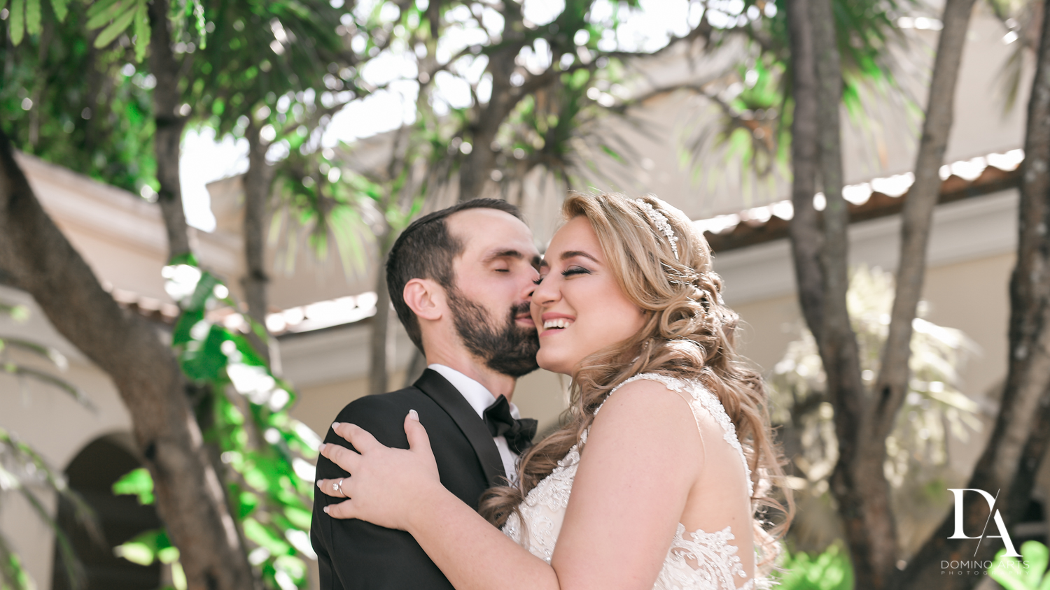 bride and groom kiss at Ultimate Events Wedding at Turnberry Isle Resort Miami by Domino Arts Photography