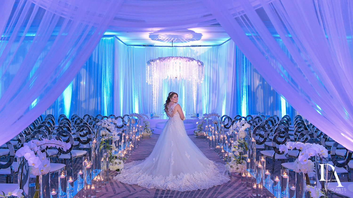Bride and ceremony decor at Ultimate Events Wedding at Turnberry Isle Resort Miami by Domino Arts Photography