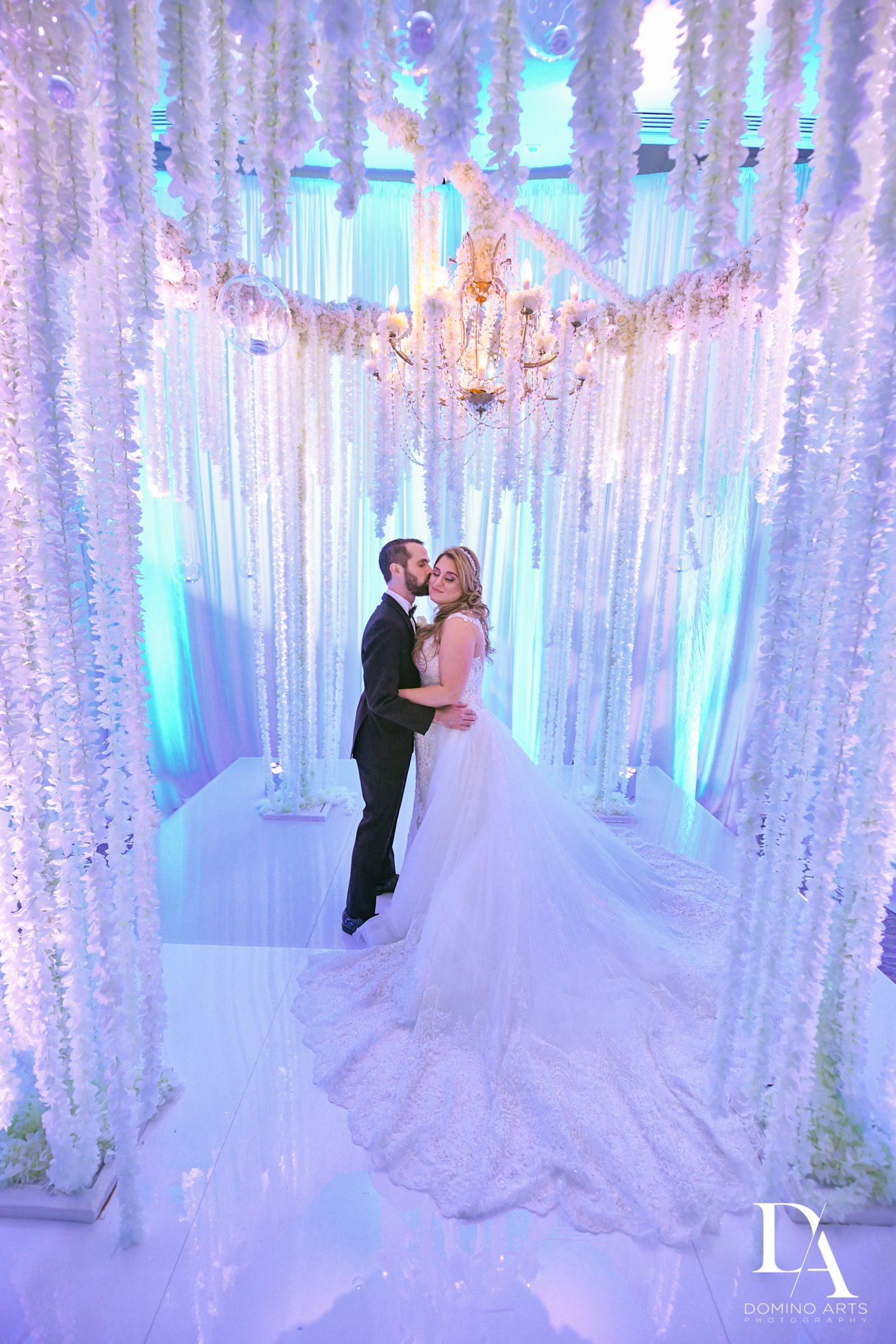 flower chuppah at Ultimate Events Wedding at Turnberry Isle Resort Miami by Domino Arts Photography