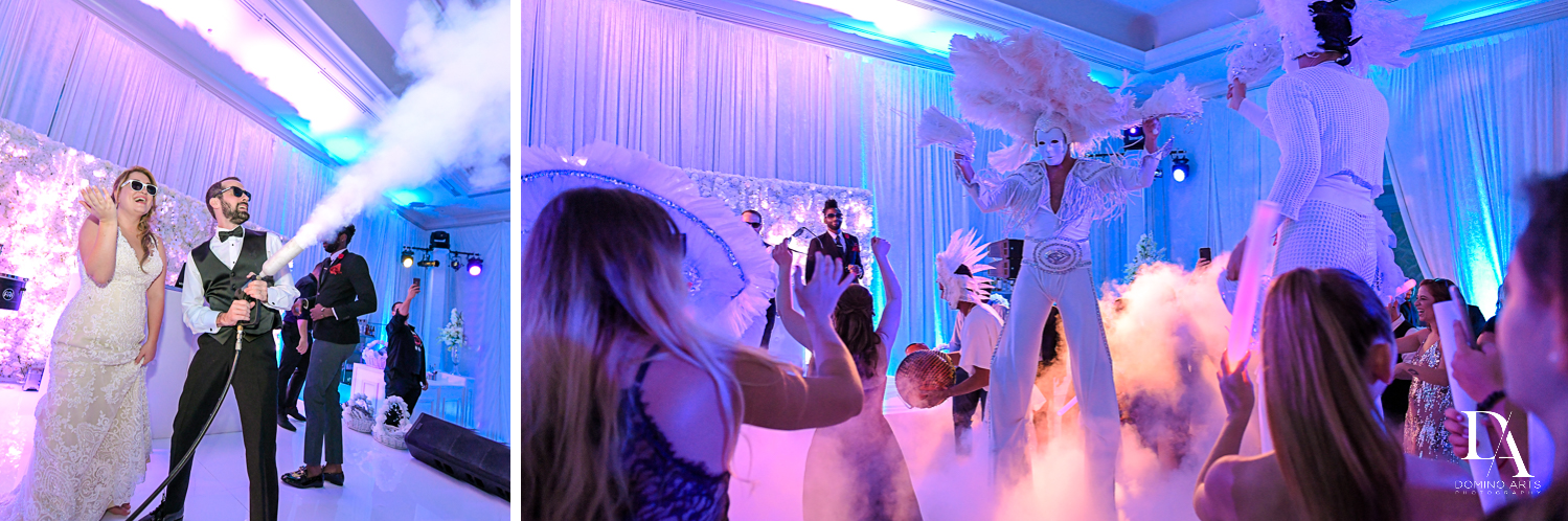 stilt entertainers at Ultimate Events Wedding at Turnberry Isle Resort Miami by Domino Arts Photography