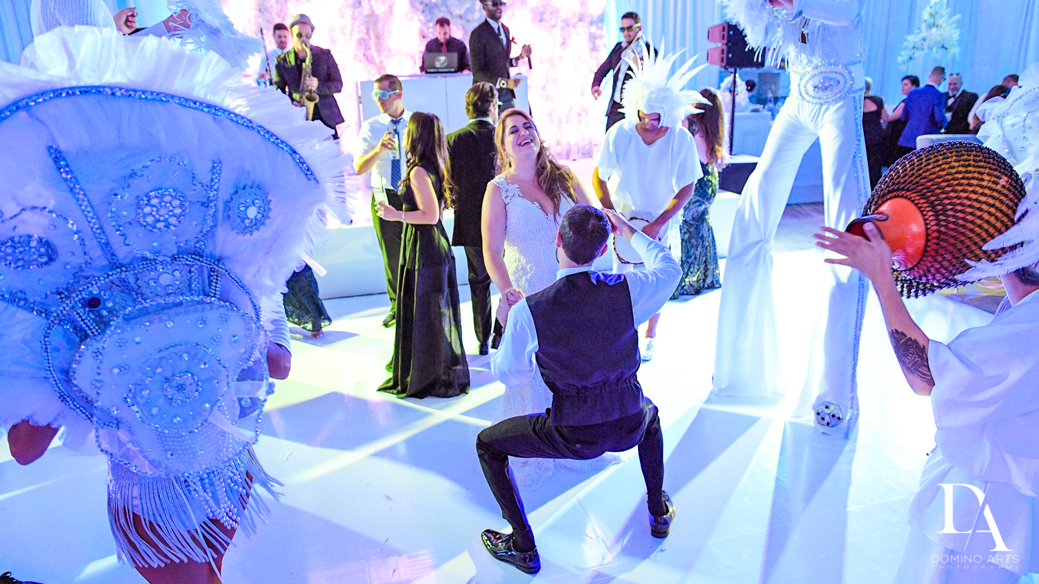 fun dancing at party Ultimate Events Wedding at Turnberry Isle Resort Miami by Domino Arts Photography