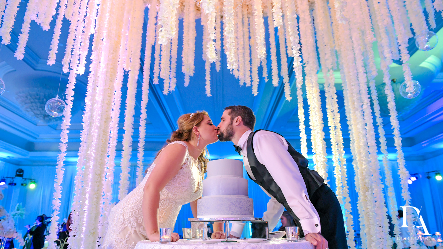 kiss and cake at Ultimate Events Wedding at Turnberry Isle Resort Miami by Domino Arts Photography