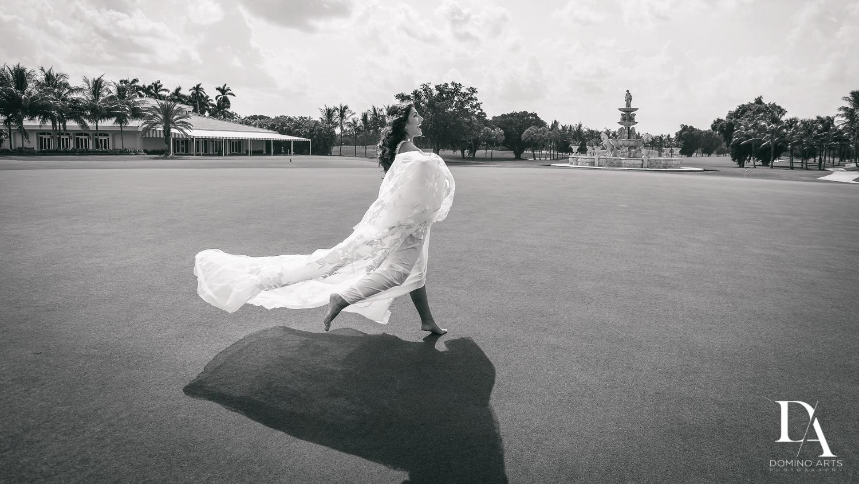 fun bride running at Elegant Classy Wedding at Trump Doral by Domino Arts Photography