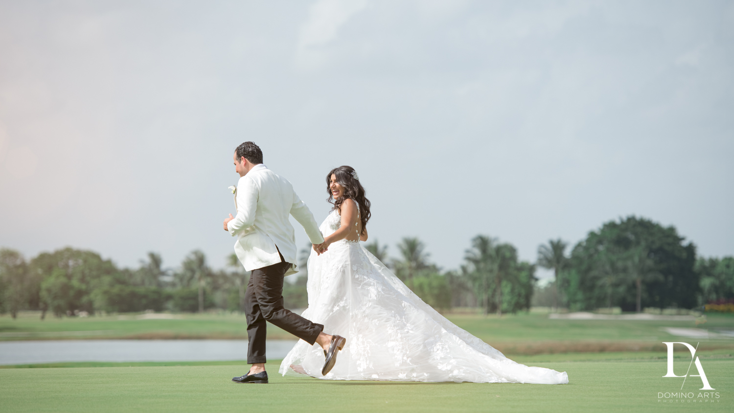 running bride and groom at Elegant Classy Wedding at Trump Doral by Domino Arts Photography