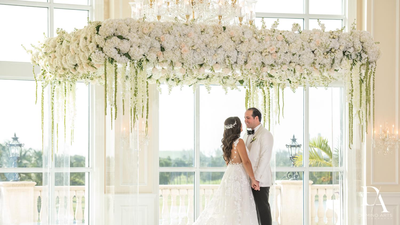 couple under chuppah at Elegant Classy Wedding at Trump Doral by Domino Arts Photography