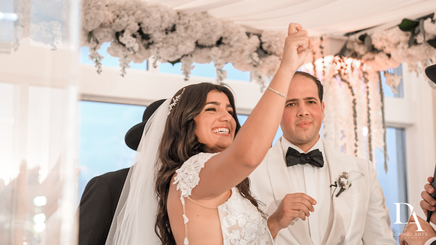 ring finger at ceremony at Elegant Classy Wedding at Trump Doral by Domino Arts Photography