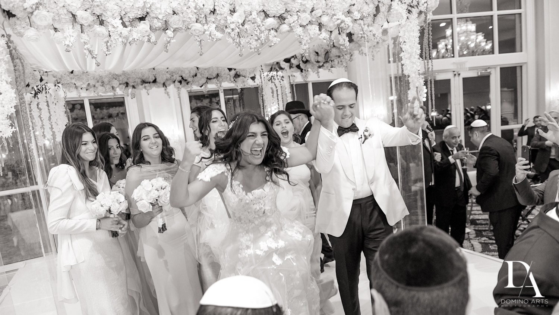 fun ceremony at Elegant Classy Wedding at Trump Doral by Domino Arts Photography