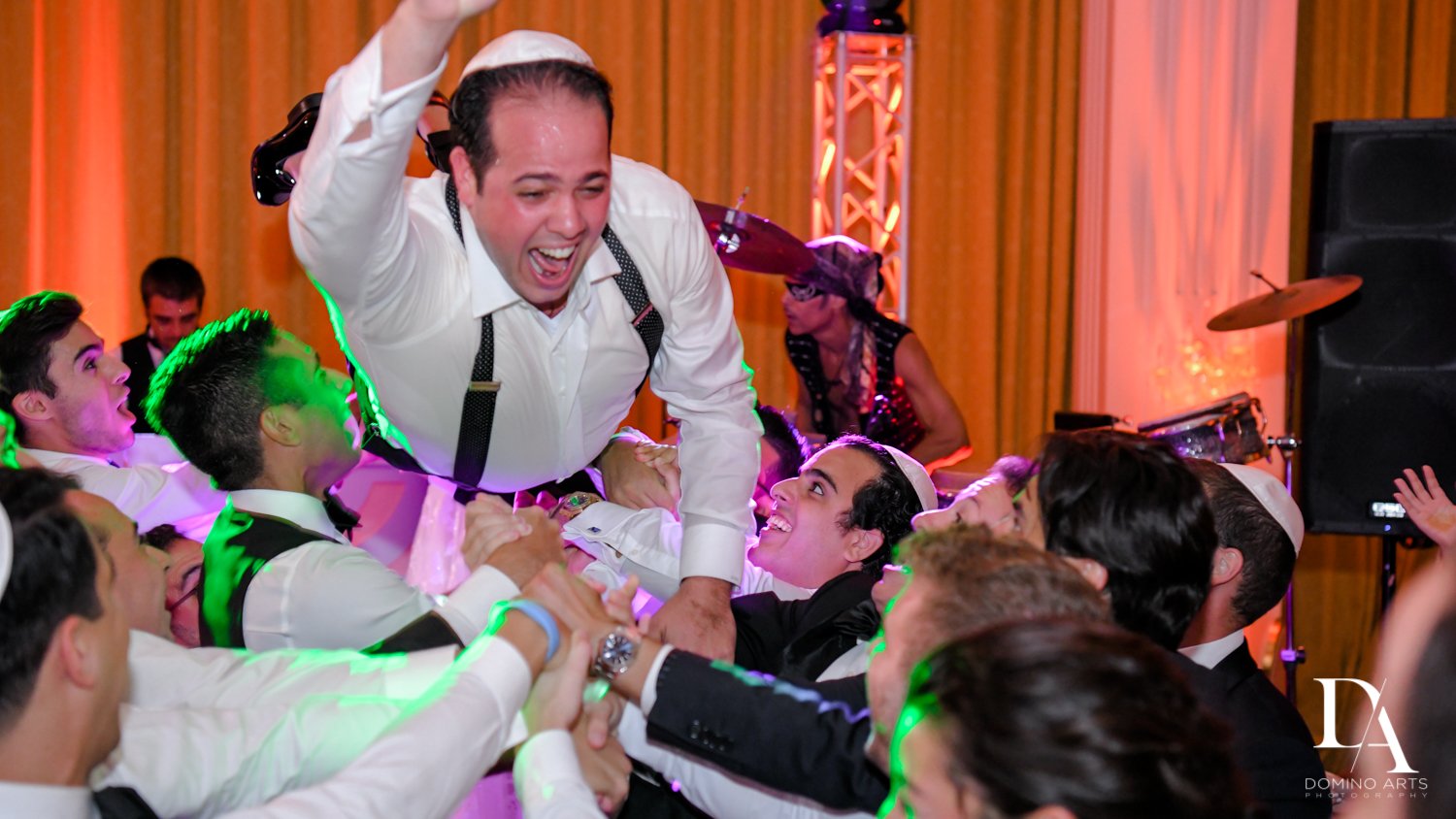 crowd surfing at Elegant Classy Wedding at Trump Doral by Domino Arts Photography