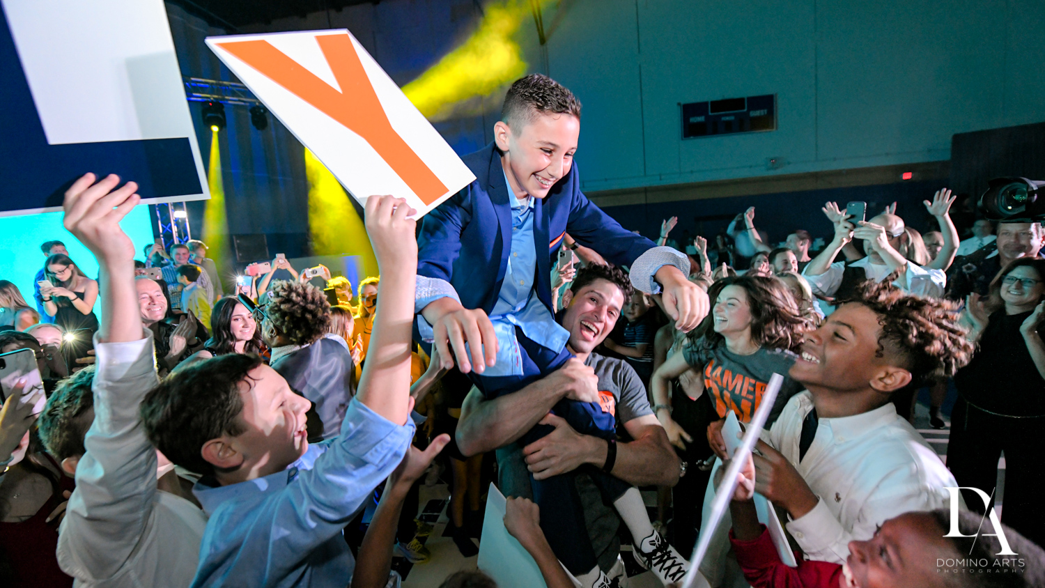 crowd surfing at Sports Theme Bar Mitzvah at DS Sports Plex by Domino Arts Photography