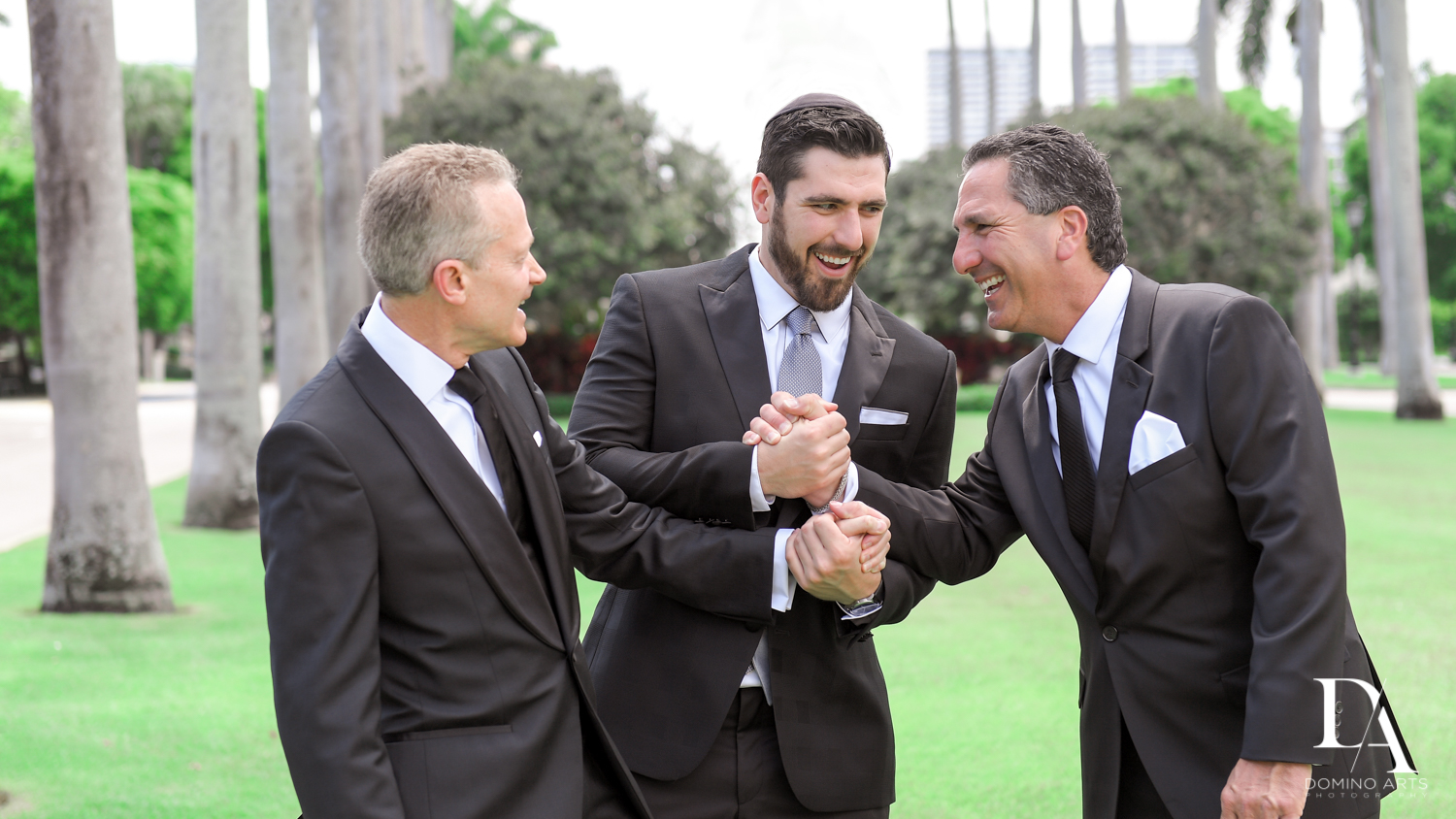 groom and dads at Vintage Garden Wedding at Flagler Museum Palm Beach by Domino Arts Photography