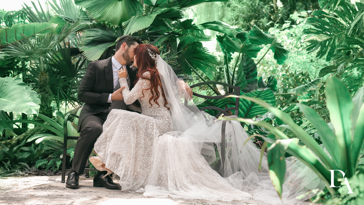 kissing couple at Vintage Garden Wedding at Flagler Museum Palm Beach by Domino Arts Photography