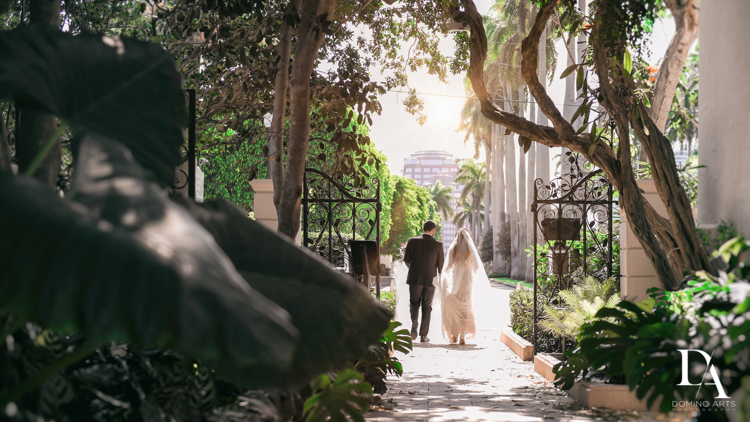 walking couple at Vintage Garden Wedding at Flagler Museum Palm Beach by Domino Arts Photography