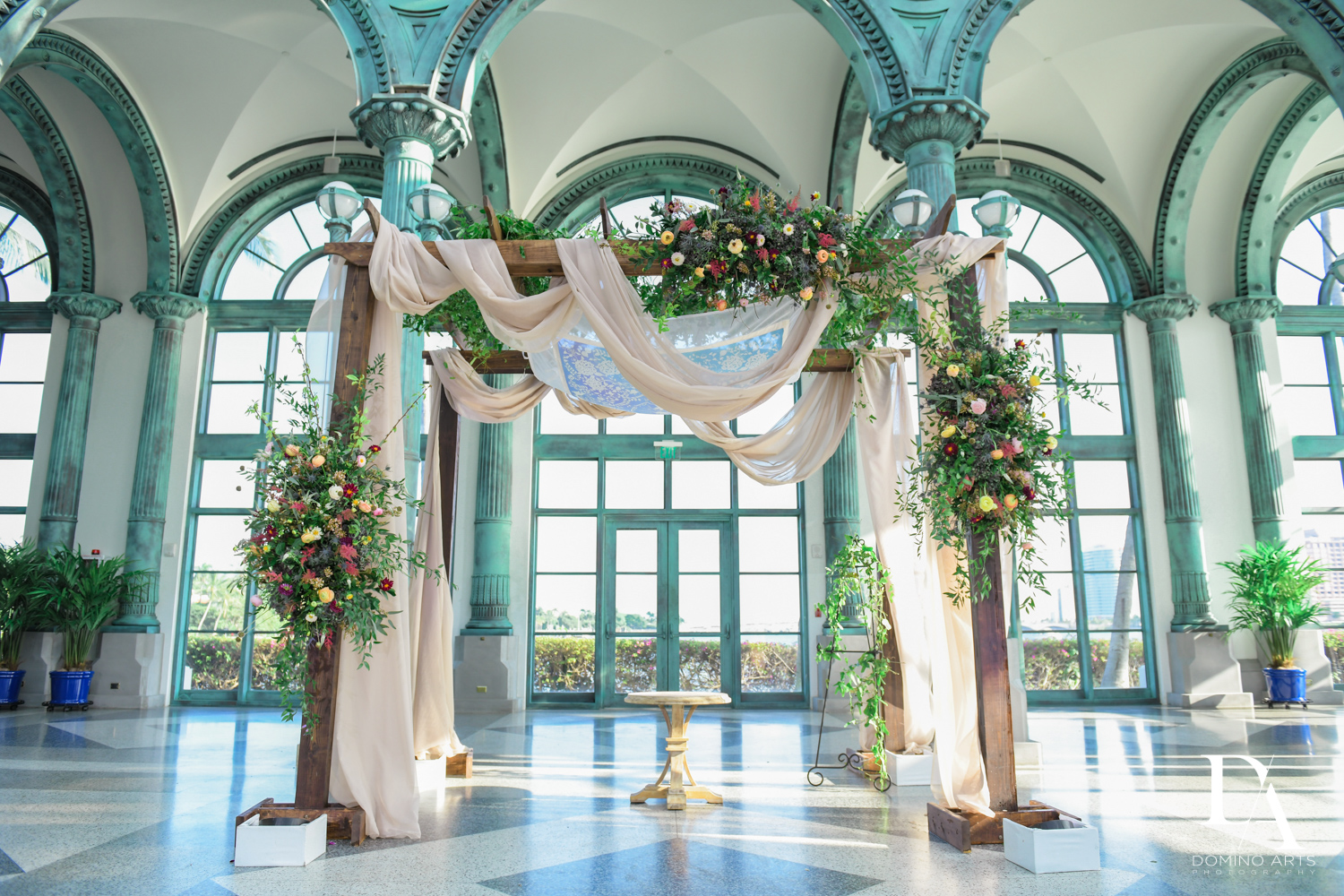 floral chuppah at Vintage Garden Wedding at Flagler Museum Palm Beach by Domino Arts Photography