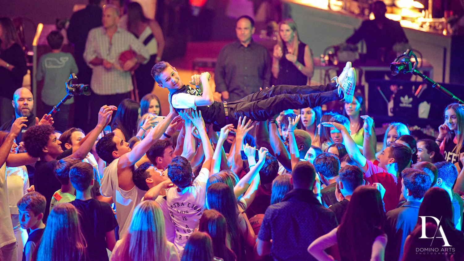 crowd surfing at Urban Graffiti BNai Mitzvah with celebrity Shaq at Xtreme Action Park by Domino Arts Photography