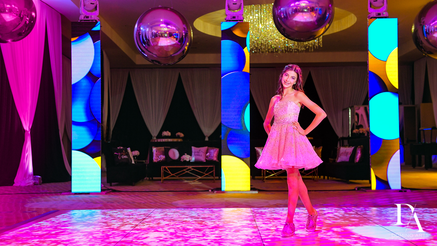 girl with colorful decor at Masquerade Ball Bat Mitzvah at Ritz Carlton Fort Lauderdale by Domino Arts Photography