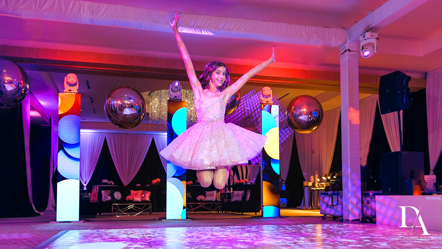 jumping photo at Masquerade Ball Bat Mitzvah at Ritz Carlton Fort Lauderdale by Domino Arts Photography
