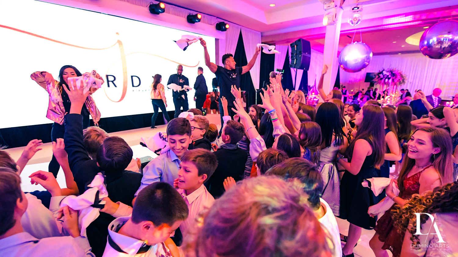 fun party at Masquerade Ball Bat Mitzvah at Ritz Carlton Fort Lauderdale by Domino Arts Photography